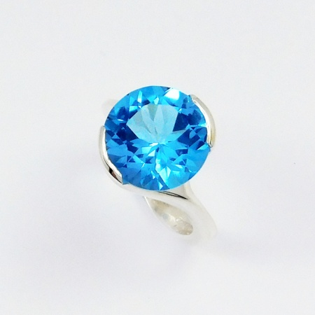 round_swiss_blue_topaz_cocktail_ring_in_silver_crop
